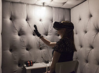 Seeing Is Believing 2016 (Participation with the Virtual Reality, Custom built glove device inside the anechoic chamber View. Silversalt photography. Model Dr Hayley Thair)  One on One Interactive Performance Installation - Virtual Reality, Mirage machine (Mediated Reality), Custom built glove device, Anechoic chamber, Acoustics  Experimental Art & Science collaborative project with Body In Mind (BIM), University of South Australia